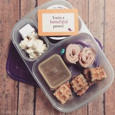 Lunch by @KeeleyMcGuire1: #SchoolLunch today is cut-up #glutenfree Van's Foods Blueberry Waffles with a small amount of syrup for dipping, turkey roll-ups, organic applesauce, organic cauliflower, and a sweet #lunchbox_love packed in an @easylunchboxes container.