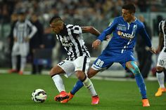 Arturo Vidal (L) of Juventus FC is challenged by Matias Vecino of Empoli FC during the Serie A match between Juventus FC and Empoli FC at Juventus Arena on April 4, 2015 in Turin, Italy.