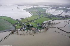 Isolated: An aerial view of Muchelney in Somerset, which has been cut off by the floods, as much of the UK continues to endure bad weather a...
