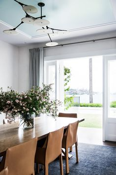 Leather dining chairs by Cassina add understated elegance to the dining room of this Mediterranean-inspired Sydney Harbour home. Photography: Brigid Arnott