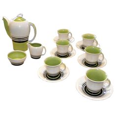 15 Piece Susie Cooper Art Deco Espresso Set England 1930's  This is an exciting Susie Cooper, 15 piece set of the striking modernist china by one of Britain's most re-known ceramicists and dinnerware designers.   With the important Kestrel coffee pot!