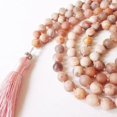 Kundalini Yoga | An Adi Shakti Mala for awakening the Divine Feminine in you. Made with matte peach moonstone and the mantra Adi Shakti. Sacred sound vibration to surround you with grace and protection. Shop now or Pin to save for later! www.mantrasandmiracles.com