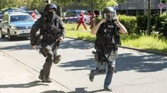 Heavily armed police outside a movie theatre complex where an armed man has reportedly opened fire on June 23, 2016 in Viernheim, Germany