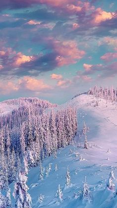 Snow covered mountaintop and beautiful pink clouds...