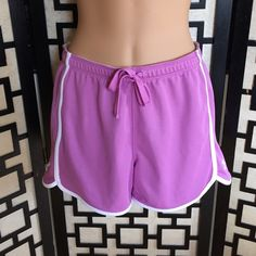 Under Armour lilac heat gear shorts Great used condition. No holes or stains. Elastic and drawstring waist. Under Armour Shorts