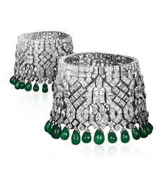 """A remarkable pair of Art Deco emerald and diamond bracelets , convertible to a """"Collier de Chien"""" made in 1926/28 by Van Cleef & Arpels."""