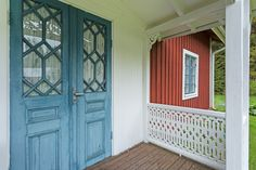 I like these in traditional blue. Swedish House, Porch, Garage Doors, Entryway, Cottage, Exterior, Cabin, Traditional, Future