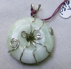 Sterling Silver Pendant - Jade Donut Wire Wrapped by JewelryArtistry - P376 - pinned by pin4etsy.com