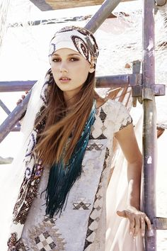Totally chic head wrap. Sometimes a scarf is becoming to long, thin hair.