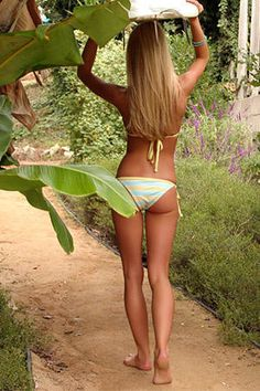Tan and toned girl in sexy bikini carrying surfboard #KyFun