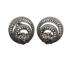 Flaunt luxury with a pair of Judith Jack sterling silver circle in circle abstract earrings. Decoratively covered  in marcasite accents, these comfortable clip earrings are sure to add sparkle to your ears. #stuff4uand4u