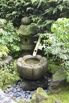 A Japanese Garden with a stone water basin for washing ones hands and drinking.