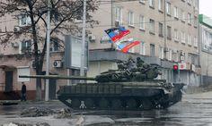 Pro-Russian separatists ride on a tank in Donetsk, eastern Ukraine, February 1, 2015.