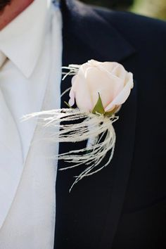 blush pink rose and feather boutonniere