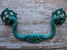 Set of 2 Vintage Style Pulls for Dressers or Cabinets Turquoise Blue and Silver Cottage Shabby Rustic Chic. $12.00, via Etsy.