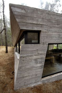 Casa de Hormigon by BAK Architects. The concrete walls give an impression of solidity and permanence next to the mature trees
