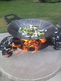 """www.hellspits.com  This is a 24"""" disc cooker / fire pit with removable wok"""