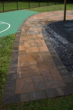 The patio is curved using Belgard Hardscapes rustic slab in danville blend with a laffit border in sable blend.