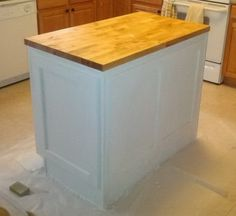 How To Make A DIY Kitchen Island And Install In Your Kitchen After the DIY kitchen island is sanded, paint the bottom your chosen color Kitchen Island Decor, Modern Kitchen Island, Kitchen Tops, Kitchen Islands, Kitchen Ideas, How To Install Kitchen Island, Unfinished Kitchen Cabinets, Cabinet Island, Building A Kitchen