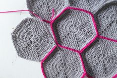 Hexagons are a fun and versatile crochet motif that can be used for a  variety of uses including blankets, table runners, doilies and potholders.  Once you have the basics down, you can change the colours or stitches in  the pattern to create designs that are uniquely your own.  This tutorial
