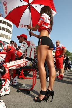 Grid Girls. How does she drive in those shoes? http://perrisautospeedway.com #autospeedway #speedway #attractions