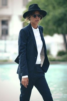 Stripe suit with hat and sunnies. Image via TheyAllHateUs