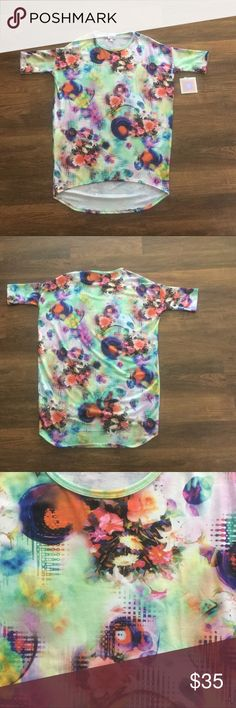 XXS Irma BNWT XXS Irma. No defects. Print is pretty wild but you could pair with a lot of different solid leggings. Per website best fits a size 00-0. LuLaRoe Tops