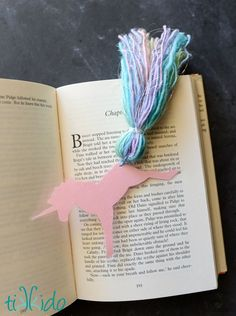 Make this enchanting unicorn bookmark using yarn, tape, and cardstock. It makes the perfect favor for a unicorn birthday party.