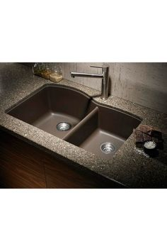 Freaking fantastic!  A granite, colored sink! I'm so tired of stainless......  Blanco Silgranit 1 3/4 Basin Undermount Kitchen Sink - Cafe Brown  www.hautelook.com