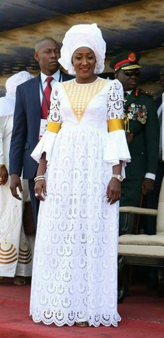 African lace dress with embroidered neckline,Dress has a wrapper underneath and fabric for a head wrap African Lace Styles, African Lace Dresses, Latest African Fashion Dresses, African Dresses For Women, African Attire, African Print Fashion, Africa Fashion, African Wear, African Women
