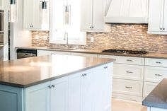 White & Bright Kitchen by Ridgeway Kitchens & Design LTD