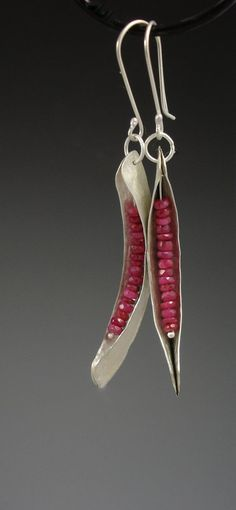 "These earrings are silver fold-formed danglers with genuine ruby ""seeds,"" now available at slathered, via Etsy."