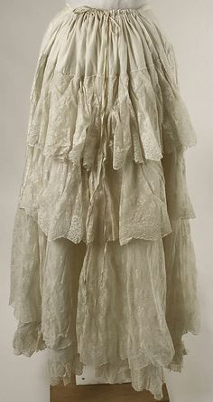 White cotton and lace ruffled petticoat (back), American, ca. 1880. Worn with matching white cotton and lace tea gown.