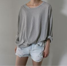 slouchy tee + rolled sleeves + distressed denim.