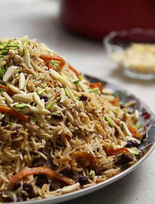 Afghan lamb pilaf (Kabuli pulao), made of steamed rice mixed with lentils, raisins, carrots and lamb.