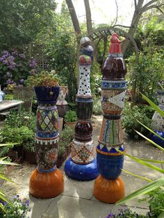 Just finished mosaic columns for my Daylesford garden. They are made from glazed and terracotta pots assembled together to form a column. Once they are in their final position I'll post some more pictures.