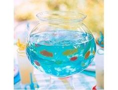 Blue Jello shots with Swedish Fish Pinnacle vodka! (Switch to small plastic shot glass)Yummm