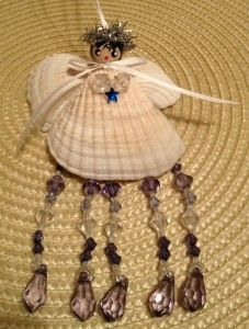 Craft Ideas Using Seashells | This angel is made using seashells, ribbon and beads. She has a ...