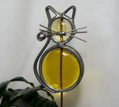 Stained Glass Yellow Cat Plant Stake. $7.00, via Etsy.