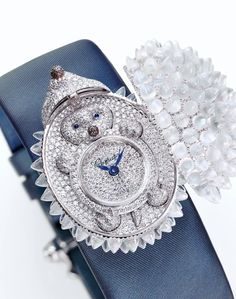 A truly fancy pants watch for Mary.) Isn't this Hedgehog Secret Watch from Animal World collection the CUTEST thing ever? 18 carat white gold set with moonstone quills and a pave-set diamond face, opening to reveal a diamond baby hedgehog! Jewelry Model, High Jewelry, Luxury Jewelry, Bling Jewelry, Jewelery, Chanel Watch, Diamond Face, Automatic Watches For Men, Chopard
