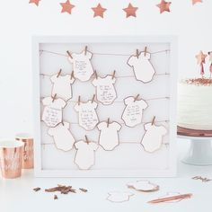 This Ginger Ray Baby Shower Guest Book Frame Kit includes a frame, tags designed to look like baby grows, pegs, and twine. Guests at your baby shower can leave their well wishes and advice with this guest book frame kit! Baby Shower Party Deko, Cadeau Baby Shower, Idee Baby Shower, Fiesta Baby Shower, Baby Party, Baby Shower Parties, Baby Boy Shower, Baby Shower Gifts, Baby Showers