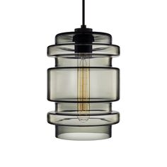 the crystalline series by niche modern from left an axia pendant in condesa a delinea pendant in gray and a calla pendant in axia modern lighting