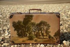 Memory suitcase - photos taken on location in Israel - by Yuval Yairi. Interesting idea...