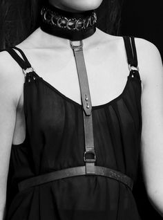 Strappy black dress with leather harness; runway fashion details