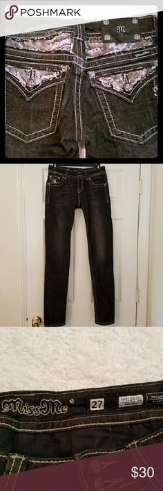 """Miss Me Faded Black Rhinestone Jeans Miss Me Jeans in great condition! Only worn once! They are black with faded front legs and feature several large and small rhinestones studded on the front and back of the pants. There is wear to the bottom back legs from the bottoms being walked on. There is fraying to the stitching as part of the design as seen in the photos.   Size 27. Inseam - 33"""" Miss Me Pants Skinny"""