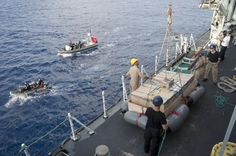 May 30,during search & inspection of a ship by a boarding team from HMCS Toronto seized approximately 6 tons of hashish.This is the Canadian ship's 5th time since March intercepting delivery of drugs shipments in the Arabian Sea.HMCS TORONTO about to get a raft of seized narcotics in the Indian Ocean, May 24, 2013,under Operation Artemis. Photo Cpl Malcolm Byers, HMCS TORONTO