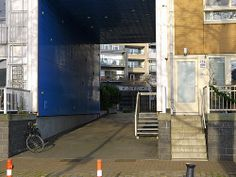 Facade & large gate of residential houses on Javakade with varying modern architecture style and colors in one building site; location: borders of river IJ in the old harbours of Amsterdam; - urban photography by Fons Heijnsbroek, the Netherlands