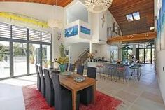 Sotheby's Auckland House- interior layout with mezzanine lookout and casual vibe Accordion Doors, Boutique Interior Design, Wooden Dining Tables, Open Plan Living, Dream Decor, Interior Architecture, Home Goods, House Plans, House Design