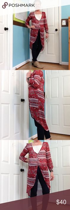 """Charlotte Russe semi sheer hi lo long kimono NWOT This is a reposh...it was never worn before today! and I'm so sad about it! I LOVE the colors and the style. But I just can't make it work! 😬 I kept pulling the sleeves up and adjusting the neck and pulling it down...etc 😂  43"""" ↕️ in back,  sleeves are 18"""" to button tab ( can't unbutton )  18"""" ↔️ armpits. Can unbutton the front. I feel like the neck is oversized, would be so cute with one of those bandeaus underneath! Charlotte Russe…"""