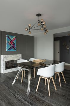 The warm, black finish combined with the geometric construction of the Bola Suspension light gives this modern dining space a bold contrast | Suspension lighting | Modern lighting for kitchens and dining areas - by Edge Lighting #modern #lights #contemporary
